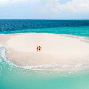 Maldives Honeymoon Package InterContinental Maldives Maamunagau Resort Couple On Sandbank