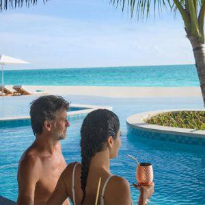Maldives Honeymoon Package InterContinental Maldives Maamunagau Resort Couple In Main Pool