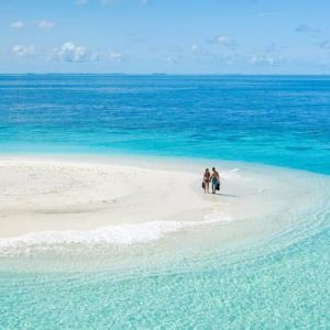 Maldives Honeymoon Packages Baglioni Maldives Resorts Couple In Sand Bank