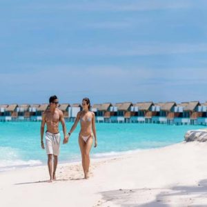 Maldives Honeymoon Packages Emerald Resort & Spa Couple On Beach