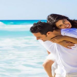 Maldives Honeymoon Packages Emerald Resort & Spa Couple On Beach1