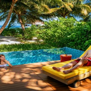 Maldives Honeymoon Packages Mercure Maldives Kooddoo Resort Couple Relaxing By The Pool
