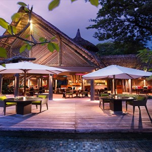Constance Ephelia - Luxury Seychelles Honeymoon Packages - Adam and Eve restaurant and bar exterior at night