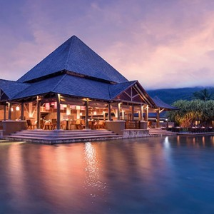 Constance Ephelia - Luxury Seychelles Honeymoon Packages - Corossol restaurant exterior at night