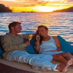 Constance Ephelia - Luxury Seychelles Honeymoon Packages - Couple enjoying champagne