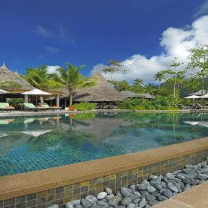 Constance Ephelia - Luxury Seychelles Honeymoon Packages - Helios restaurant and bar pool view
