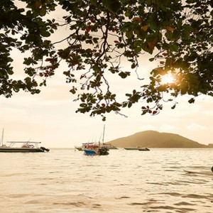 Constance Ephelia - Luxury Seychelles Honeymoon Packages - stand up paddling at sunset