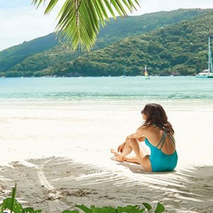 Constance Ephelia - Luxury Seychelles Honeymoon Packages - woman on beach