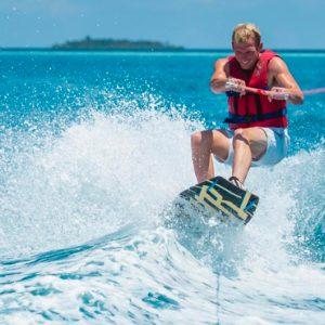 Maldives Honeymoon Packages Banyan Tree Vabbinfaru Boat Surfing
