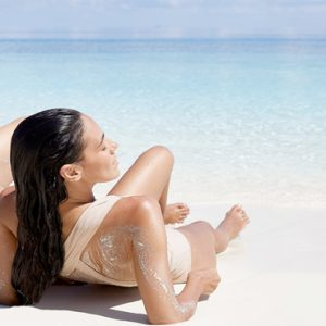 Maldives Honeymoon Packages Conrad Maldives Rangali Island Couple Relaxing On Beach