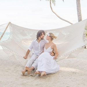 Maldives Honeymoon Packages Conrad Maldives Rangali Island Couple On Hammock