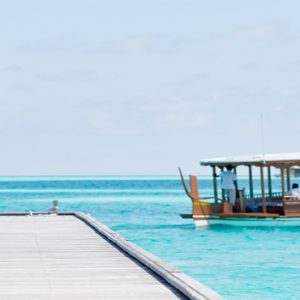 Maldives Honeymoon Packages Conrad Maldives Rangali Island Woman On Bridge