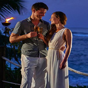 Hilton Seychelles Labriz Resort & Spa - Luxury Seychelles Honeymoon Packages - Couple enjoying a drink at night