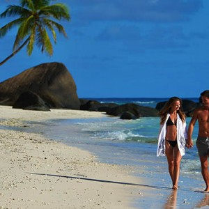 Hilton Seychelles Labriz Resort & Spa - Luxury Seychelles Honeymoon Packages - Couple romantic stroll on beach