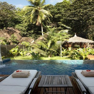 Hilton Seychelles Labriz Resort & Spa - Luxury Seychelles Honeymoon Packages - Sanctuary Pool Villa sun loungers by pool