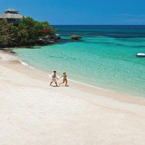 Jamaica Honeymoon Packages Sandals Ochi Beach Resort Couple Walking On Beach