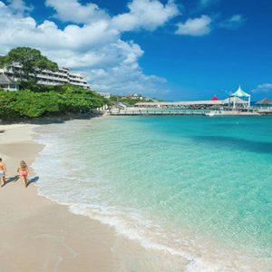 Jamaica Honeymoon Packages Sandals Ochi Beach Resort Couple Walking On Beach1