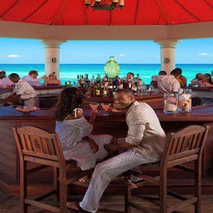Jamaica Honeymoon Packages Sandals Ochi Beach Resort Couples At The Bar