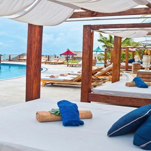 Jamaica Honeymoon Packages Sandals Ochi Beach Resort Day Bed By The Pool