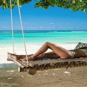 Jamaica Honeymoon Packages Sandals Ochi Beach Resort Women Relaxing On Swing Hammock