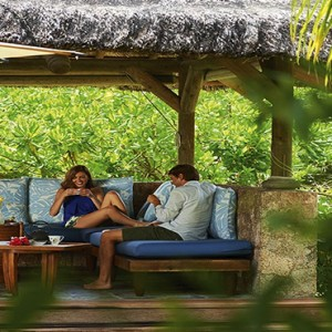 Constance Lemuria - Luxury Seychelles Honeymoon Packages - Beach villa with pool couple relaxing