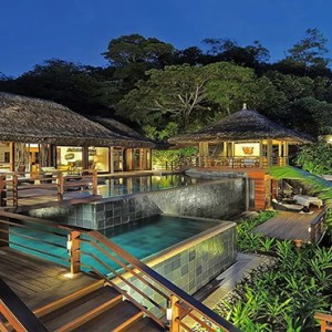 Constance Lemuria - Luxury Seychelles Honeymoon Packages - Presidential villa exterior at night
