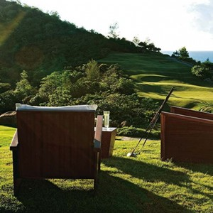 Constance Lemuria - Luxury Seychelles Honeymoon Packages - relaxing on the golf course