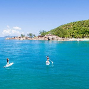 Constance Lemuria - Luxury Seychelles Honeymoon Packages - stand up paddling