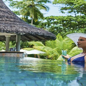 Constance Lemuria - Luxury Seychelles Honeymoon Packages - woman in pool