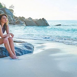 Constance Lemuria - Luxury Seychelles Honeymoon Packages - women chilling on beach