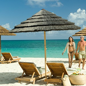 Beach couple - Sandals Emeral Bay Golf Tennis and Spa Resort - Luxury Bahamas Holidays