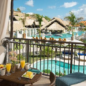 Grenada Honeymoon Packages Sandals Grenada South Seas Waterfall River Pool Junior Suite With Balcony Tranquility Soaking Tub2