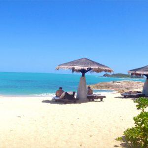 Thailand Honeymoon Packages The Tongsai Bay, Koh Samui Relaxing On Beach