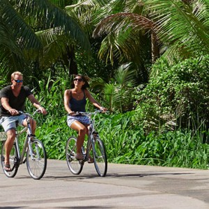 Banyan Tree Seychelles - Luxury Seychelles Honeymoon Packages - Couple cycling