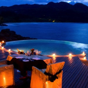 Banyan Tree Seychelles - Luxury Seychelles Honeymoon Packages - Dining by the pool at night