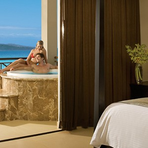 Luxury Honeymoon Packages - Secrets Wild Orchid Montego Bay - bedroom