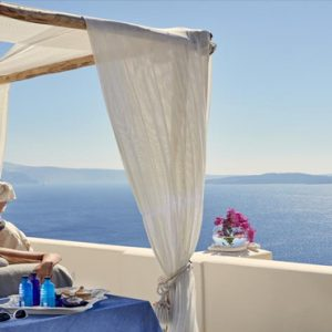 Greece Honeymoon Packages Canaves Oia Suites Spa Massage On Balcony