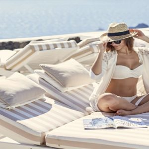 Greece Honeymoon Packages Canaves Oia Suites Women Relaxing On Daybed