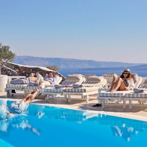 Greece Honeymoon Packages Canaves Oia Suites Relaxing By Infinity Pool