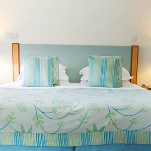 Calabash Hotel - Grenada Honeymoon Packages - bed