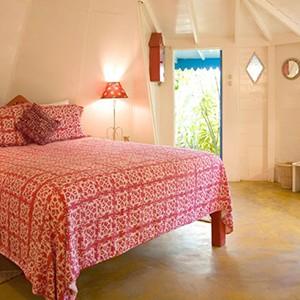 The Caves - Jamaica Honeymoon Packages - bedroom