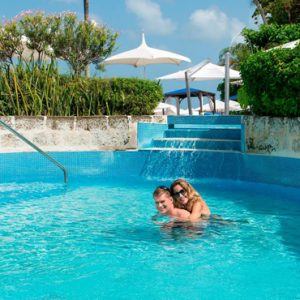 Couple In A Swimming Pool The House Barbados By Elegant Hotels Barbados Honeymoons