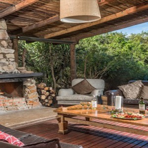 Kariega Game Reserve - Luxury South Africa Honeymoon Packages - Main lodge living area with fireplace