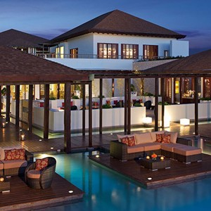 secrets playa mujeres - mexico honeymoon packages - outdoor lounge