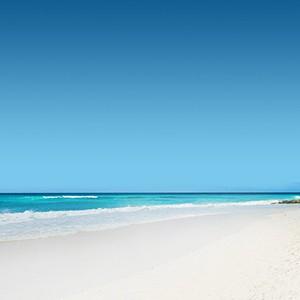 Beach Couple - Sandals Barbados - Luxury Barbados Honeymoon Packages