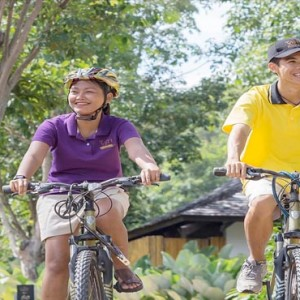 The Vijitt - Luxury Thailand Honeymoon Packages - couple bike riding