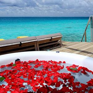 centara ras fushi - maldives honeymoon packages - premium deluxe spa water villa 2