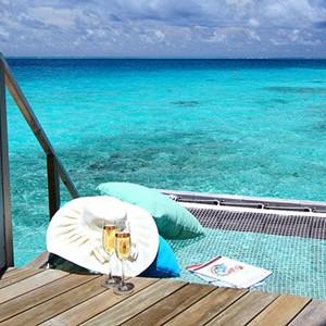 centara ras fushi - maldives honeymoon packages - premium deluxe spa water villa