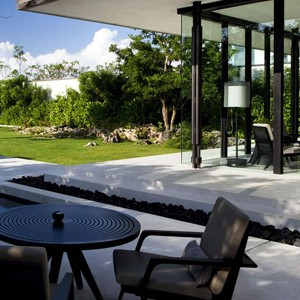 alila villas uluwatu - bali honeymoon packages - table and chairs