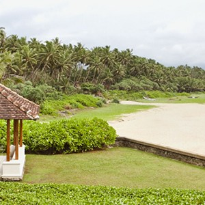 saman villas - sri lanka luxury honeymoons - garden loungers